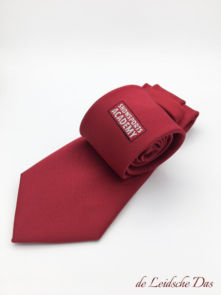Custom made neckties in a solid color with logo that we made for snowsports academy