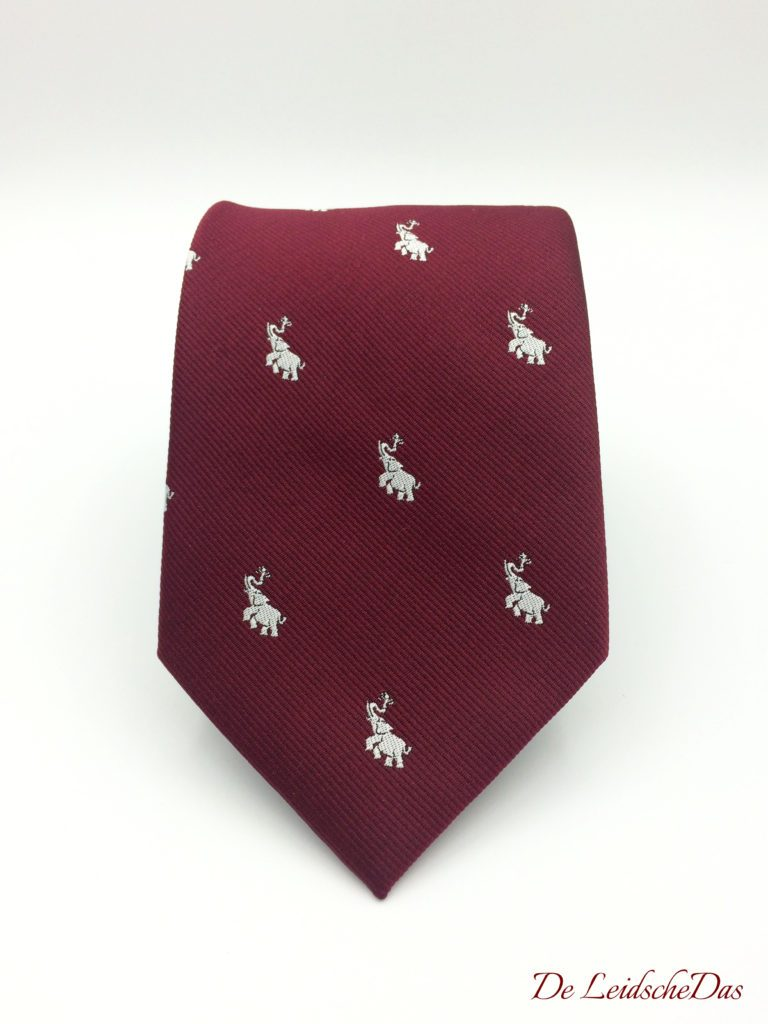 Custom neckties woven in a solid color with recurring logo of a elephant, personalized neckties