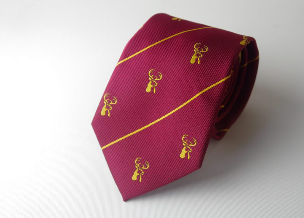 Custom neckties in your club colors with recurring club crest, custom woven ties