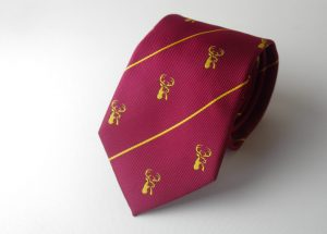 Custom ties in your club colors with recurring club crest, custom woven ties