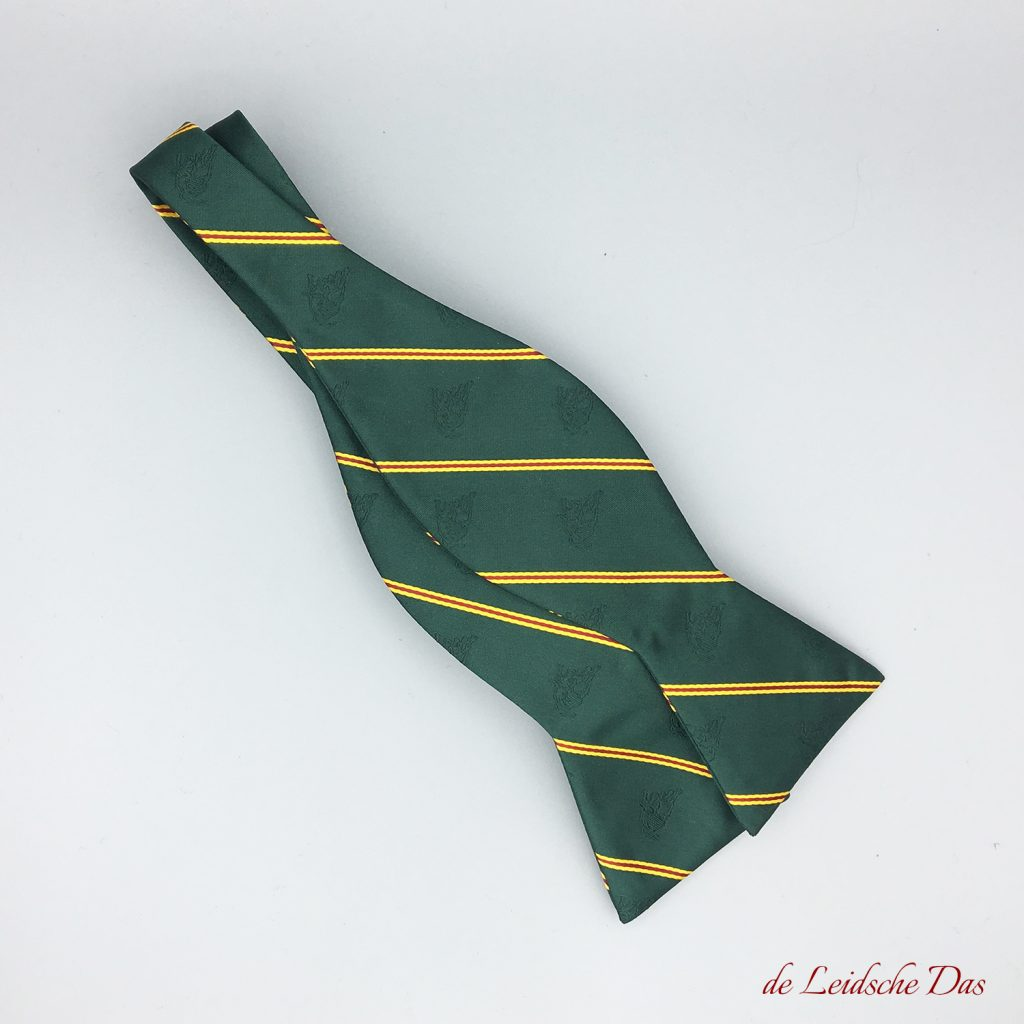 A bow tie with logo, crest or coat of arms custom woven in your personalized bow tie design
