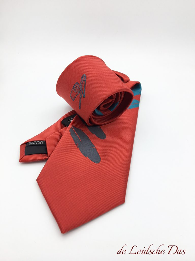 Tailor made necktie with logo we made in a custom necktie design for the hospitality industry