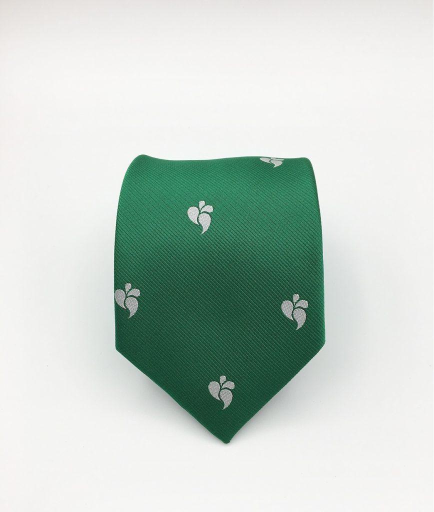 Custom designed hand-crafted silk ties in green with recurring logos, custom woven silk ties