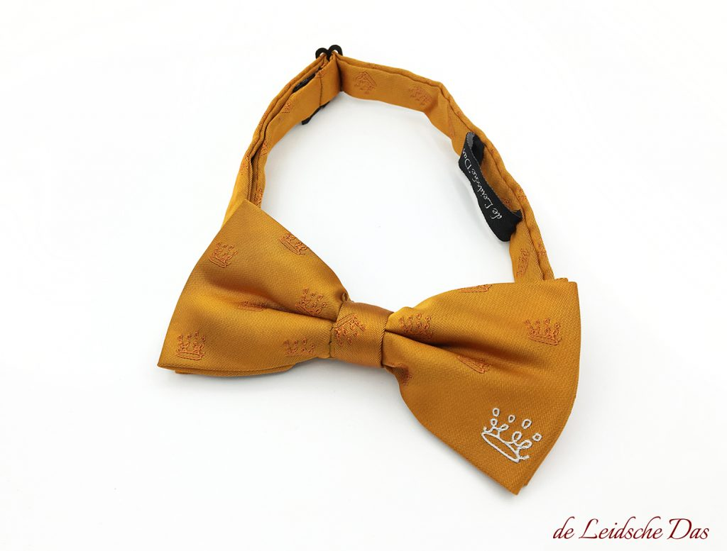 Custom made pre-tied orange tuxedo bow tie with logo in white and recurring logos