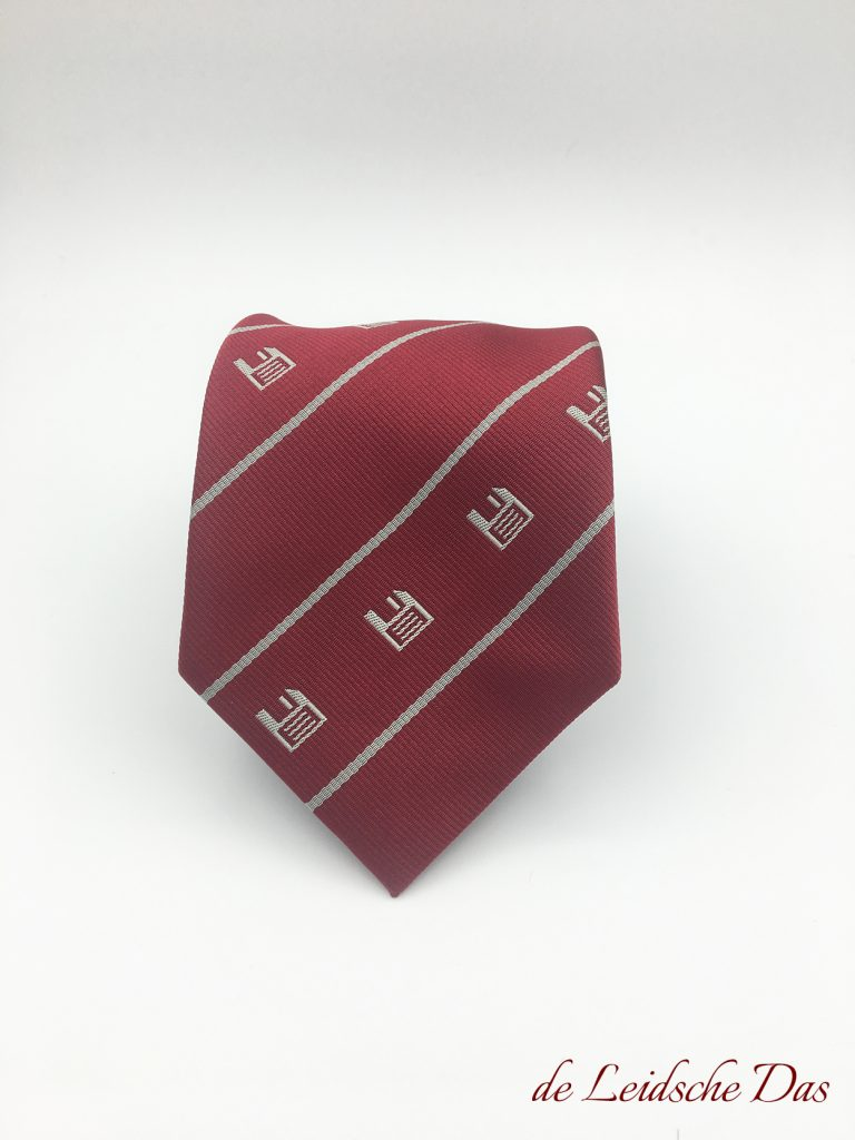 Red logo tie with recurring company logos woven in a custom made tie design