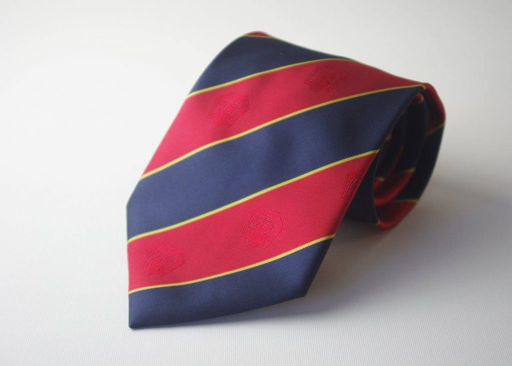Custom made club tie with red and blue stripes and yellow lines and subtle club emblems