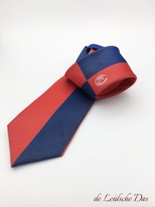 Club tie which features an insignia, woven in a custom tie pattern in club colors with an club insignia