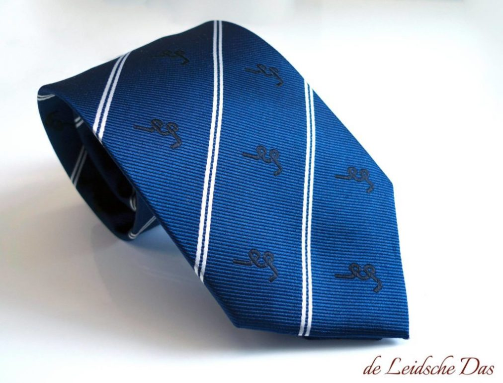 Custom woven blue ties with white lines and repeating logos in diagonal perpendicular weave