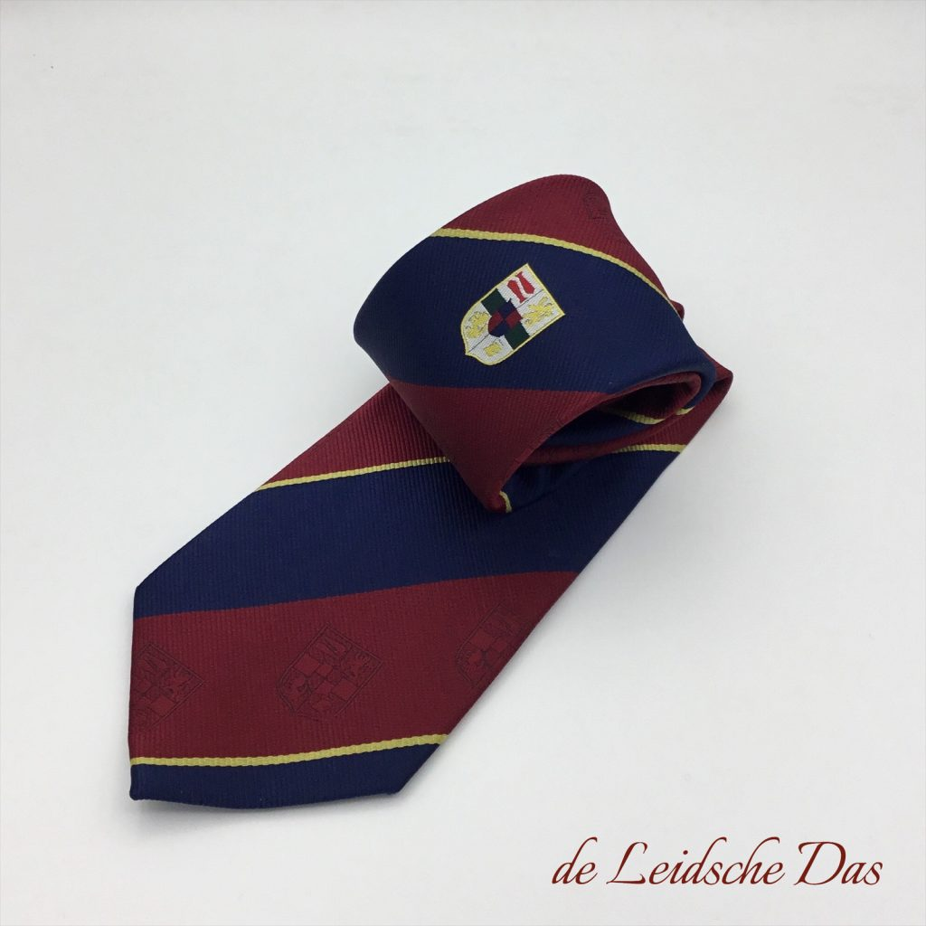 Personlized tie design nr. 633, custom weaved ties with a centered main logo and subtle repeating logos in the red stripes